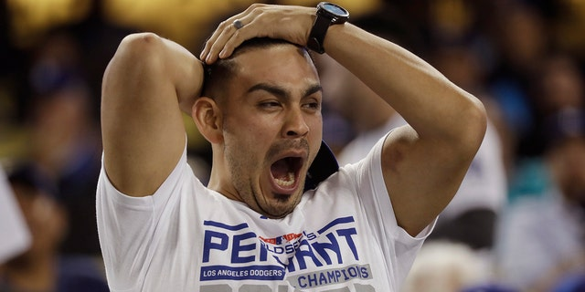 A fan yawns before the start of the 17th inning in Game 3 of the World Series baseball game between the Boston Red Sox and Los Angeles Dodgers on Friday in Los Angeles.  Dodgers top Red Sox, 3-2, in marathon 18-inning Game 3 of World Series dodgers fan yawning 1