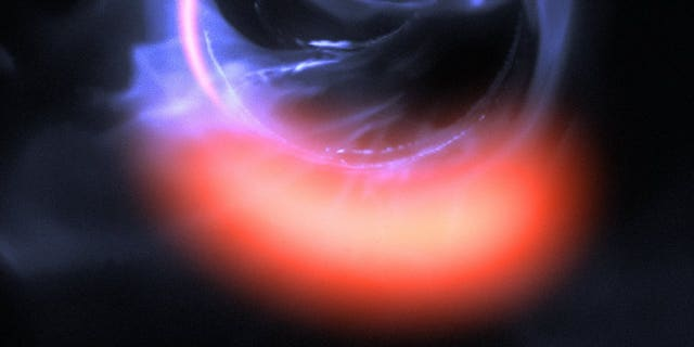 This simulation shows a hot blob of gas falling toward a black hole at 30 percent of the speed of light.