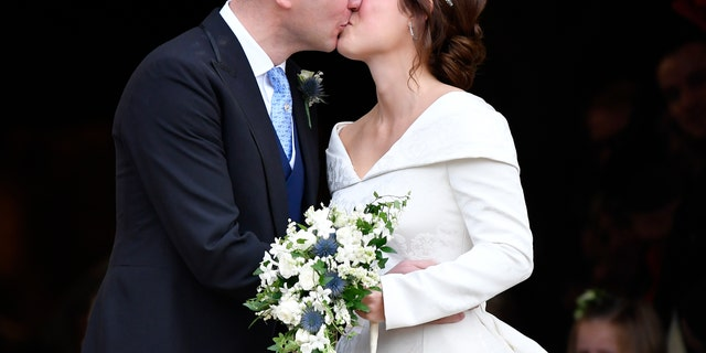 Princess Eugenie and Jack Brooksbank kiss after their wedding.