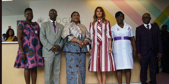 First lady Melania Trump, third from right, and Ghana's first lady Rebecca Akufo-Addo, third from left, pose with hospital personnel at Greater Accra Regional Hospital in Accra, Ghana, Tuesday, Oct. 2, 2018. Mrs. Trump is visiting Africa on her first big solo international trip, aiming to make child well-being the focus of a five-day, four-country tour. (AP Photo/Carolyn Kaster)