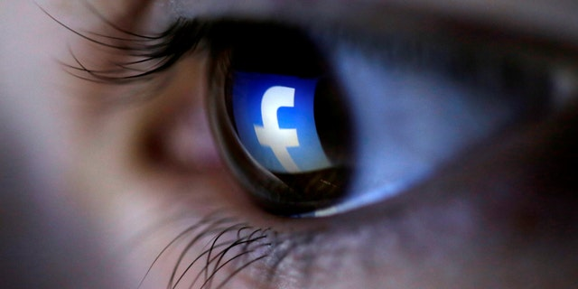 FILE PHOTO: A picture illustration shows a Facebook logo reflected in a person's eye, in Zenica, March 13, 2015. REUTERS/Dado Ruvic/Illustration/File Photo - RC180D53B7F0