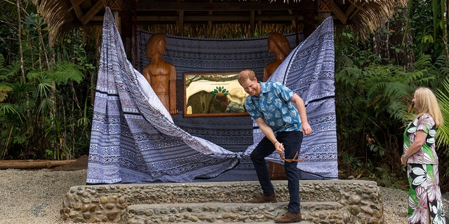 Prince Harry, Duke of Sussex, unveils a plaque during a dedication of the Colo-i-Suva forest to the Queen's Commonwealth Canopy in Suva, Fiji, on Wednesday, Oct. 24, 2018.