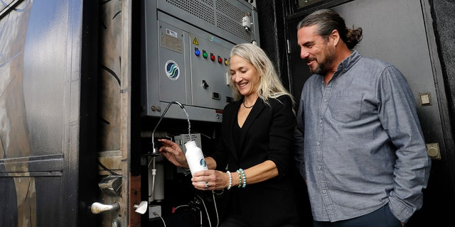 The Skysource/Skywater Alliance co-founders David Hertz, right, and his wife Laura Doss-Hertz demonstrate how the Skywater 300 works Wednesday in Los Angeles.