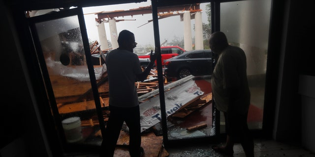 .Hotel employees look at a canopy that just collapsed, as Hurricane Michael passes through in Panama City Beach