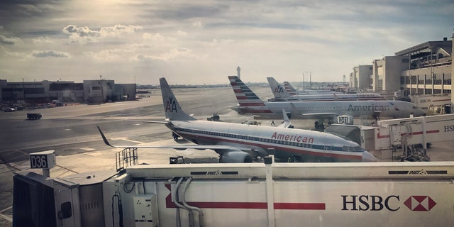 Airplanes are being prepared for flights in Miami International Airport.