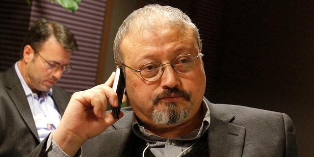 Saudi Arabian journalist Jamal Khashoggi speaks on his cell phone at the World Economic Forum in Davos, Switzerland, in 2011.