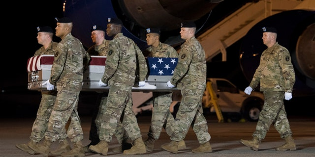 A U.S. Army carry team transferred the remains of Sgt. James Slape of Morehead City, N.C., at Dover Air Force Base in Delaware on Saturday.