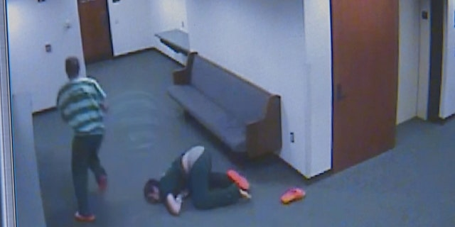 Kodey Howard can be seen falling on his face and losing a shoe as he attempted to follow Tanner Jacobson when they bolted from the courtroom.