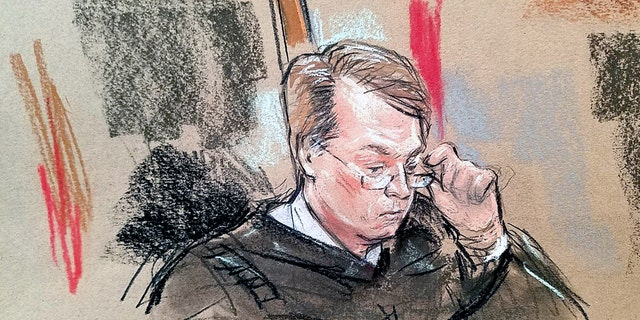Justice Brett Kavanaugh adjusts his glasses in the courtroom, in this sketch.