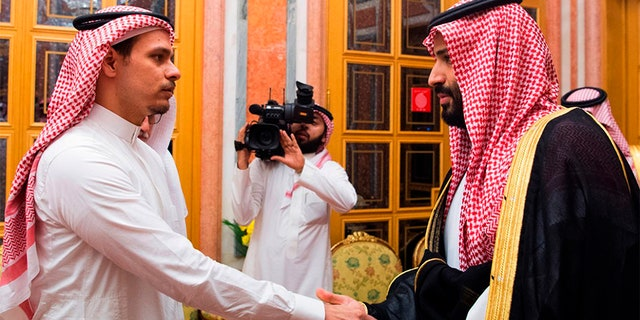 Saudi Crown Prince Mohammed bin Salman, right, shakes hands with Salah Khashoggi, a son, of Jamal Khashoggi, in Riyadh, Saudi Arabia.