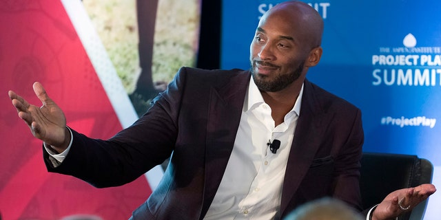 Former NBA basketball all-star Kobe Bryant gestures as he moderates a panel about youth sports during the Aspen Institute's Project Play Summit in Washington on Oct. 16.