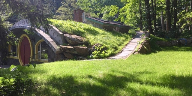 The acreage includes a small stream with walking bridge, pond, and waterfall.<br>