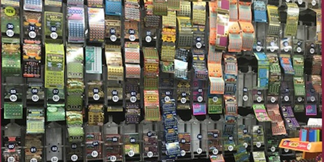 The Station Grocery, a favorite spot in East Boston, offers a wall full of different lottery options.