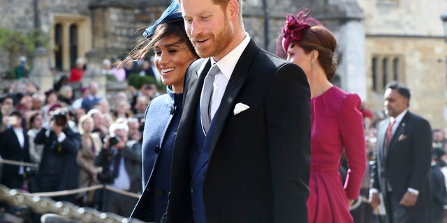 Britain's Prince Harry and Meghan Duchess of Sussex leave after the wedding of Princess Eugenie to Jack Brooksbank.