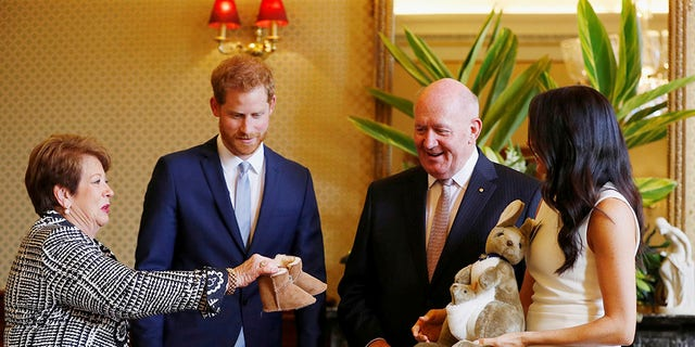 Prince Harry and Meghan Markle receive gifts from Australia's Governor General Sir Peter Cosgrove and his wife Lady Cosgrove at Admiralty House in Sydney, Australia on Oct. 16, 2018.