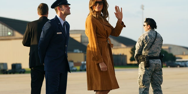 First lady Melania Trump boards a plane, Monday, Oct. 1, in Andrews Air Force Base, Md., en route to Africa