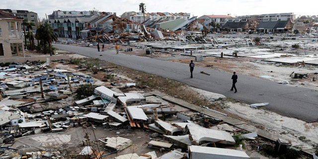 Rescue personnel search amidst debris in the aftermath of Hurricane Michael in Mexico Beach, Fla.