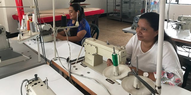 Mothers Diana Gualteros, 33 and Lucelly Foreno, 44 have taken advantage of the emerald mining resurgence to start their own sewing shop