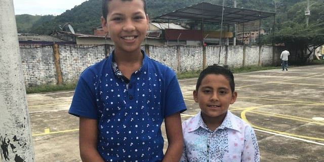 Coscuez locals Edison, 12 and Daniel, 8 ahead of English languages lessons.