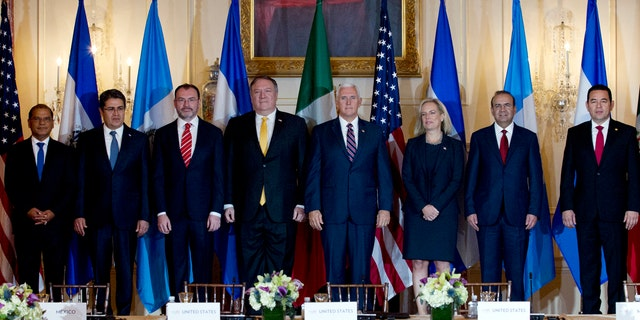 From left; Vice President Oscar Ortiz of El Salvador, Honduran President Juan Orlando Hernandez, Mexico Foreign Secretary Luis Videgaray, U.S. Secretary of State Mike Pompeo, Vice President Mike Pence, Secretary of Homeland Security Kirstjen Nielsen, Mexico Secretary of Government Alfonso Navarrete and Guatemalan President Jimmy Morales pose for a photos before the second Conference for Prosperity and Security in Central America at State Department on Thursday.