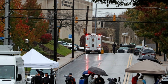Media tents and vehicles line an intersection near the Tree of Life Synagogue, upper left, where a shooter opened fire Saturday, Oct. 27, 2018.