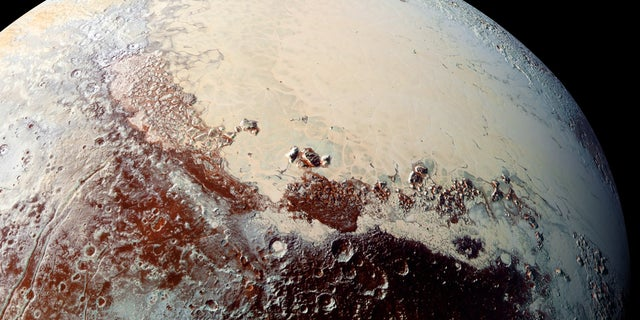 Pluto, as seen by NASA's New Horizons booster during a epic flyby of a dwarf universe in Jul 2015.