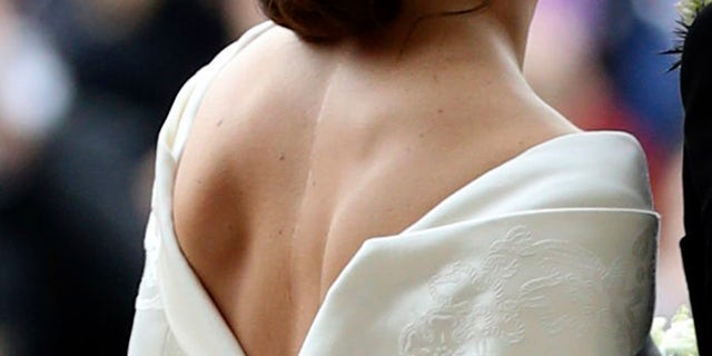 Princess Eugenie of York shows off her scar in her wedding dress on Friday, Oct. 12, 2018.