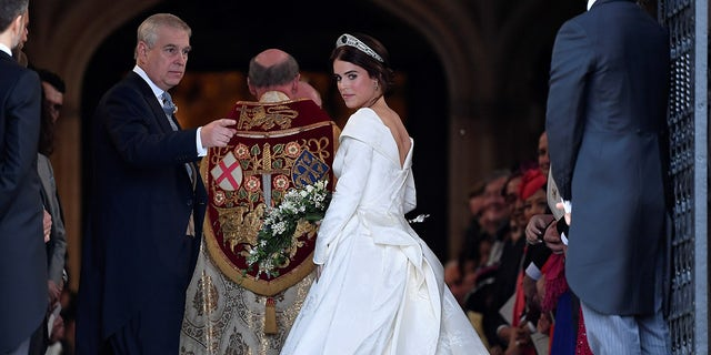 Britain's Princess Eugenie enters St George's Chapel with her father Prince Andrew, Duke of York, for her wedding to Jack Brooksbank in Windsor Castle, Windsor, Britain October 12, 2018. REUTERS/Toby Melville - RC11C0AD5490