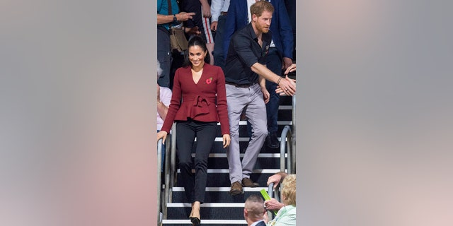 Britain's Prince Harry and Meghan, Duchess of Sussex arrive to watch the wheelchair basketball final at The Invictus Games in Sydney, Australia, Saturday, Oct. 27, 2018. Prince Harry and his wife Meghan are on day twelve of their 16-day tour of Australia and the South Pacific.(AP Photo)