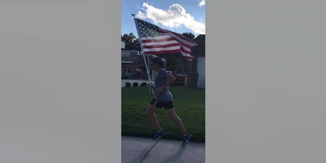 """Parfitt said his favorite aspect of running with the flag is holding it """"high and proud."""""""