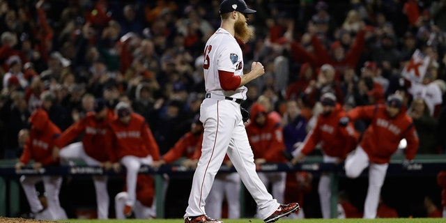Boston Red Sox's Craig Kimbrel celebrates after Game 1 of the World Series baseball game against the Los Angeles Dodgers on Tuesday in Boston.