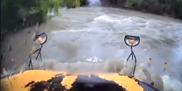 In the video, Young can be seen attempting to drive through floodwaters before the bus is washed off the road.