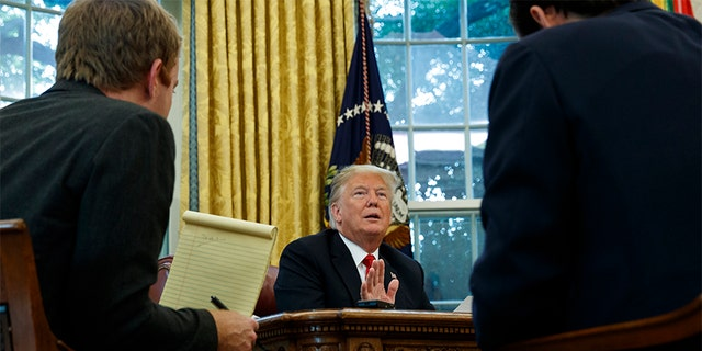 President Donald Trump speaks during an interview with The Associated Press in the Oval Office of the White House on Tuesday in Washington.