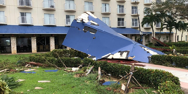 Residents of the U.S. territory braced Thursday for months without electricity or running water after the islands were slammed with the strongest storm to hit any part of the U.S. this year. (AP Photo/Dean Sensui)