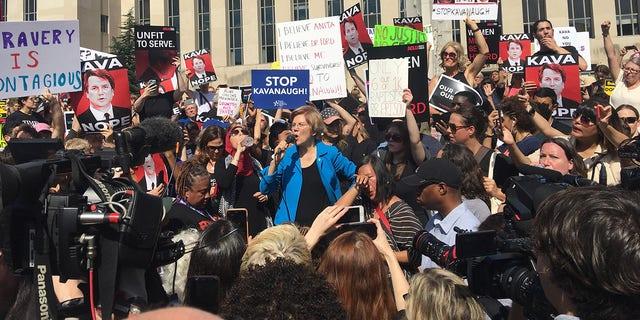Elizabeth Warren speaks Thursday at an anti-Brett Kavanaugh rally outside the Barrett Prettyman Courthouse in Washington, where Kavanaugh currently works as a United States Circuit Judge. (Alex Pappas/Fox News)