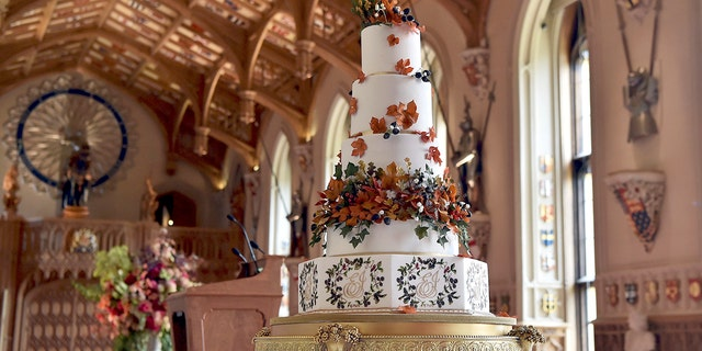 The wedding cake created by Sophie Cabot for the wedding of Princess Eugenie of York and Jack Brooksbank is seen at St George's Hall, Windsor Castle, near London, England, Friday Oct. 12, 2018.