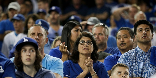 Los Angeles Dodgers fans watch during the 13th inning in Game 3 of the World Series baseball game against the Boston Red Sox on Friday, Oct. 26, 2018, in Los Angeles. (Associated Press)  Dodgers top Red Sox, 3-2, in marathon 18-inning Game 3 of World Series world series fans