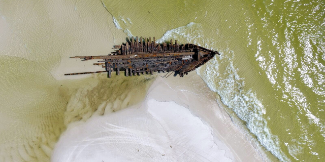 Smith took drone footage of the wreckage. The ships were destroyed during a hurricane in 1899.