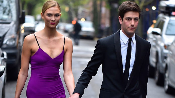 Karlie Kloss shuts down pregnancy rumors, attributes curved stomach to her love of French fries