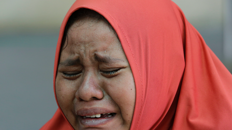 Indonesian officials fear 5,000 missing as Christians pray