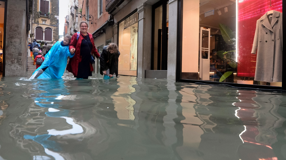 Venice sinks under water as flooding hits Italy, killing at least 6