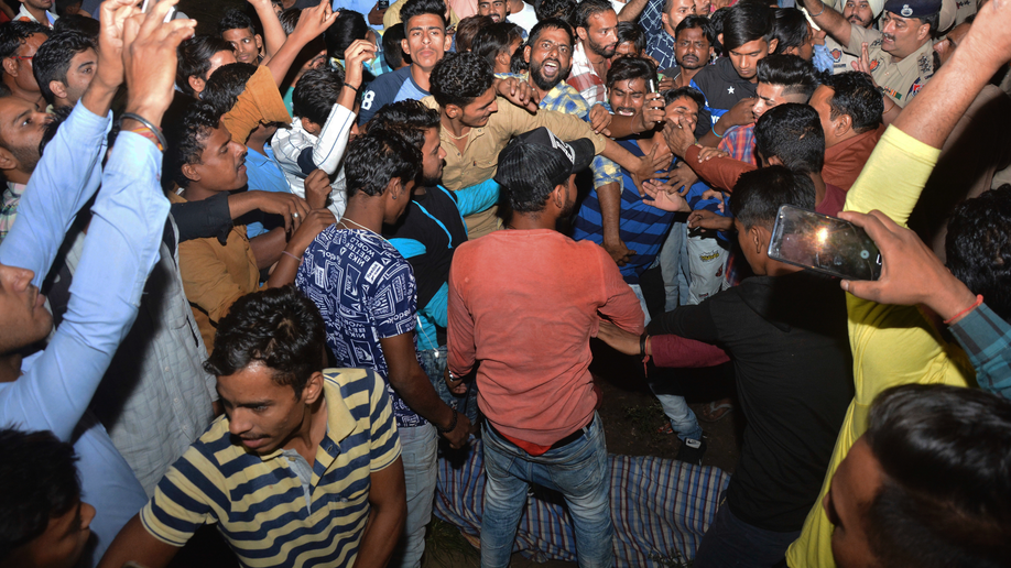 Dozens Feared Dead As Train Plows Through Crowd Of Revelers In India