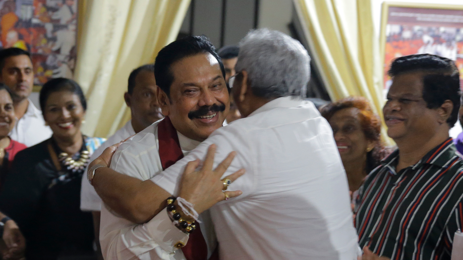 Turmoil in Sri Lanka as ex-president Rajapaksa sworn in as PM