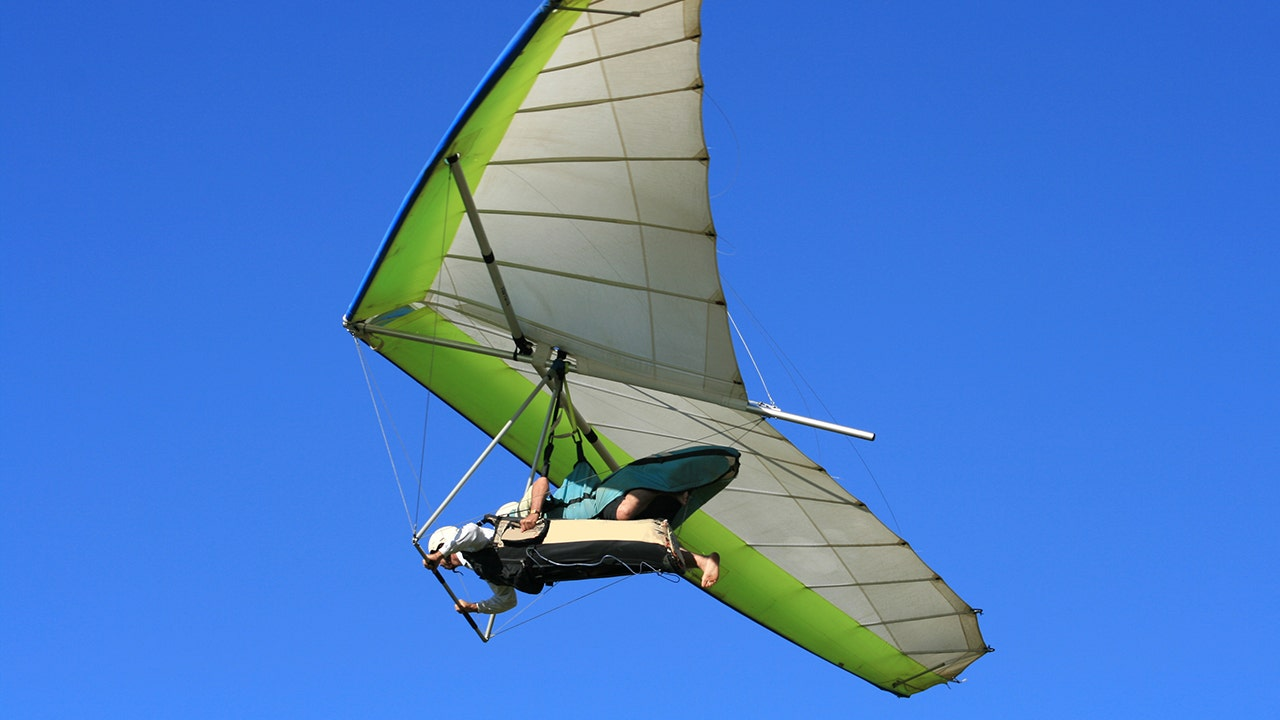 hang glider clutches to aircraft at 4 000 feet after pilot forgets