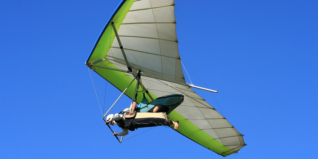 Hang glider clutches to aircraft at 4,000 feet after pilot