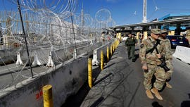 Guardsman charged with smuggling migrants into US