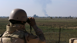 Iraqi town fearful as battle against IS rages next door
