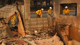 The Latest: Southern California buildings burned top 400