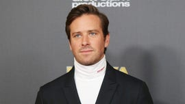 Armie Hammer shares bizarre shirtless video of himself chugging beer, golfing