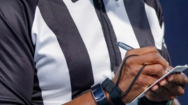 Illinois parent accused of wearing referee uniform to son's playoff game to influence outcome, suit says
